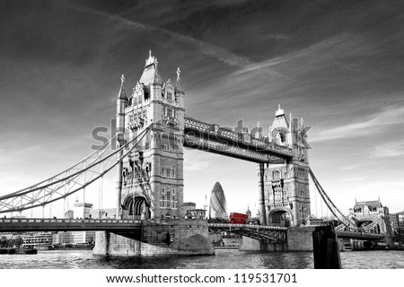 Traditional Red Route-master Bus driving across Tower Bridge - stock photo