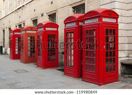 Traditional red telephone boxes in London, UK - stock photo