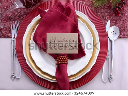 Traditional red theme festive table place setting for Thanksgiving dinner party table. - stock photo