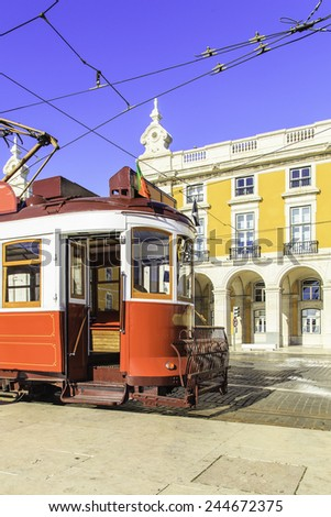 Traditional red tram one a street near Praca de Comercio in Lisbon, Portugal - stock photo