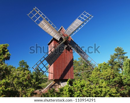 Traditional red windmill - stock photo