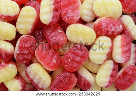 Traditional rhubarb and custard boiled sweets as an abstract background texture - stock photo