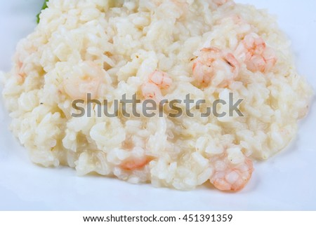 Traditional Risotto with shrimps and astaragus - stock photo