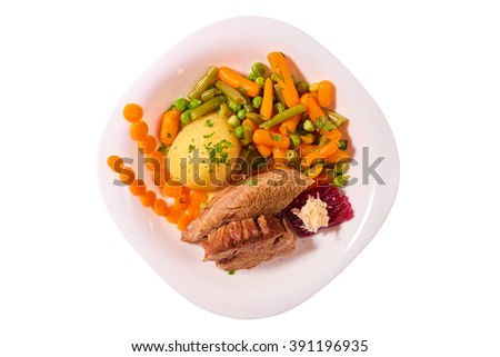 Traditional Romanian calf boiled meat with boiled vegetables on white plate, isolated on white background, top view
