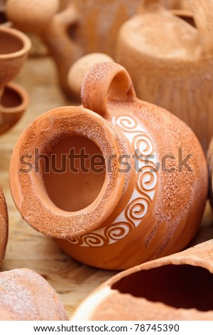 Traditional Romanian earthenware pottery at Horezu ceramic pottery fair in Romania. See the whole series