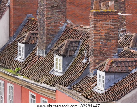 Traditional rooftops in an old part of the city of Bristol UK - stock photo