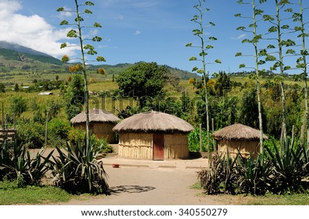 Traditional round mud house in africa near Arusha in Tanzania - stock photo