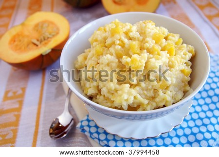 Traditional russian cuisine dish - millet porridge with pumpkin, nutritional, health-giving and very tasty, very good for family breakfast - stock photo