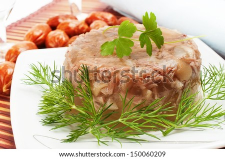 Traditional Russian food. Aspic chicken jelly. - stock photo