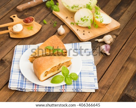Traditional Russian food. Vegetarian dish. Cabbage pie. Homemade pie with cabbage. Russian cabbage pie. Russian cuisine. Vegetable pie - stock photo