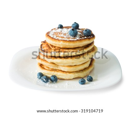 traditional russian puncakes with blueberry isolated on white background - stock photo