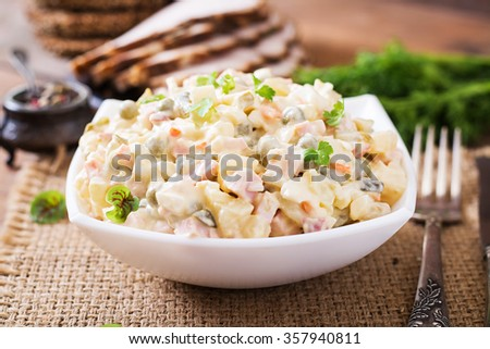 """Traditional Russian salad """"Olivier"""" - stock photo"""