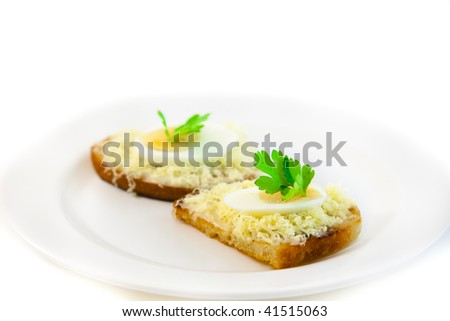 Traditional russian side dish for soup - Garlic bread with mayonnaise and cheese decorated with egg and parsley