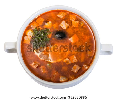 Traditional russian soljanka. Russian soup saltwort in round plate, isolated on white background.