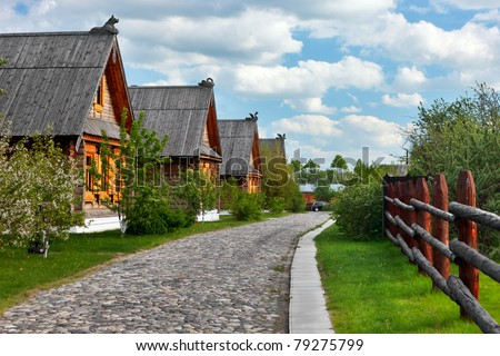 Traditional russian wooden houses for guests and tourists of ancient town Suzdal. - stock photo