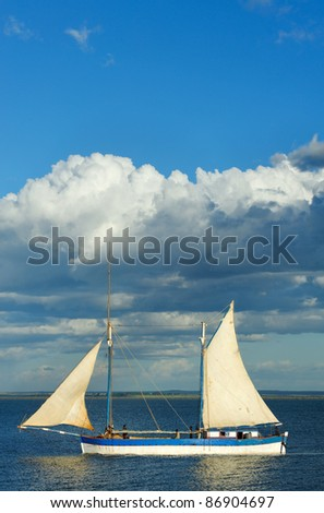 Traditional sailboat back to the harbour - stock photo