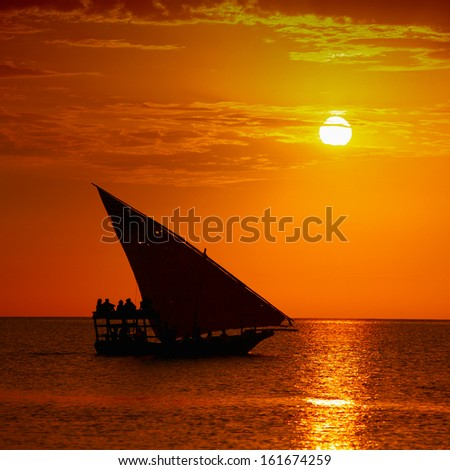 Traditional sailboat on sunset in the Indian Ocean