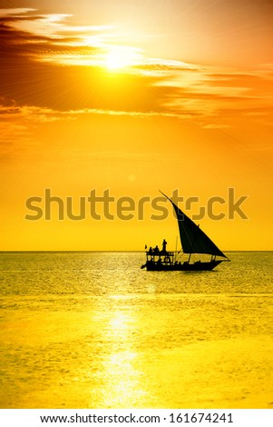 Traditional sailboat with tourist on sunset. Lens flare suggestion
