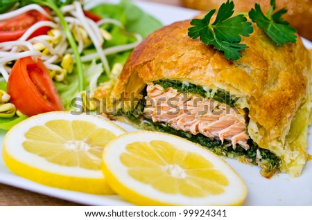 Traditional salmon in puff pastry with spinach