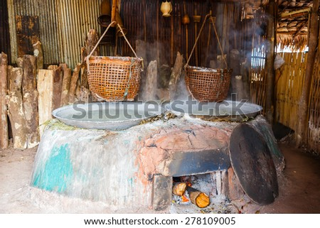 Traditional salt making by boiled with old method in Nan, Thailand - stock photo