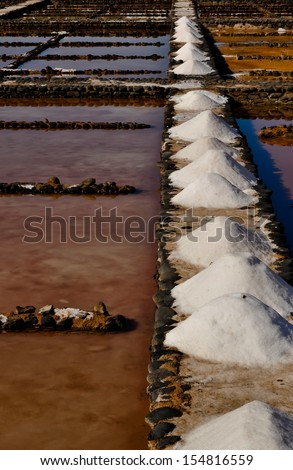 Traditional salt produced from ocean water. Salinas del Carmen. Fuerteventura - stock photo