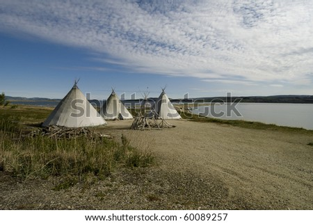 Traditional Sami reindeer-skin tents (lappish yurts) in Finnmark region of Norway - stock photo