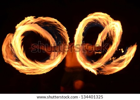 Traditional Samoan fire dancer practicing ancient ritual - stock photo