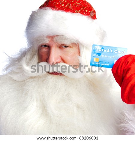 "Traditional Santa Claus holding and sowing credit card while giving a big ""ho ho ho"" belly laugh. Isolated on white."
