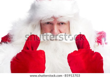 Traditional Santa Claus thumbs up. Isolated on white. - stock photo