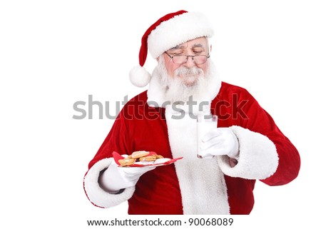 Traditional Santa with Christmas gingerbread cookies and a glass of milk, isolated on white background - stock photo