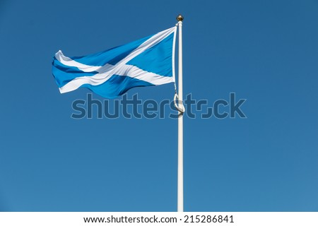 Traditional Scottish flag in front of a clear blue sky, flapping in the wind of the Highlands shortly before the referendum on Independence