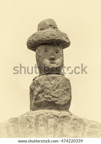Traditional sculpture standing on a Rocky Arch on Taquile Island - Titicaca lake, Peru, South America (stylized retro)