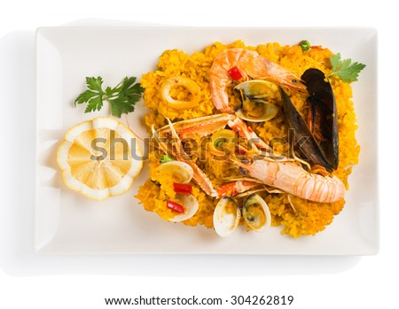 Traditional seafood paella  on white dish isolated over white top view. - stock photo