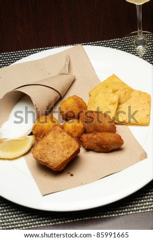 traditional sicilian fried panelle and croquettes with salt - stock photo