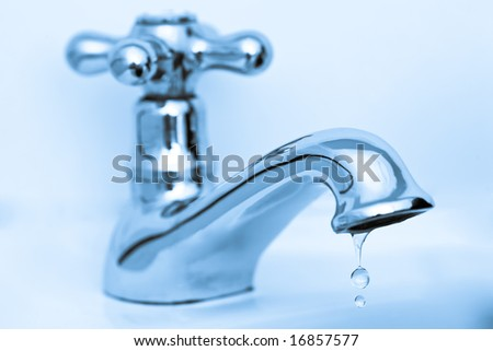 Traditional silver tap dripping - stock photo