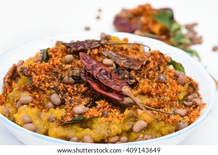 Traditional South Indian pumpkin curry / dish Kerala, India. seasoned, curry leaves, coconut oil,Indian spices for cooking. Lentils, side dish for rice/ coconut rice in traditional Onam sadhya, Vishu