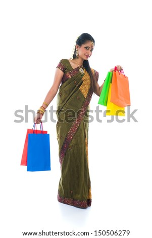 traditional South Indian woman holding Deepavali shopping bags and smiling  - stock photo