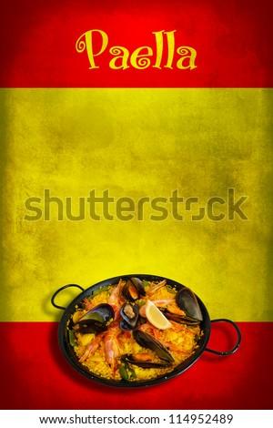 Traditional spanish dish: paella valenciana on spanish flag - stock photo