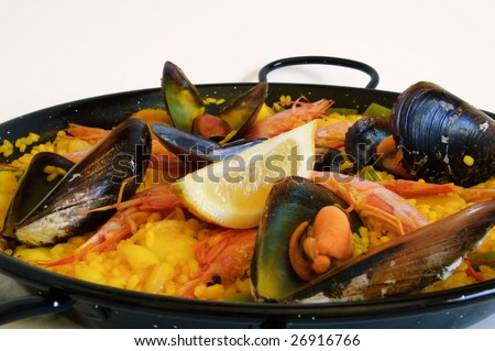 Traditional spanish rice: paella and seafood - stock photo