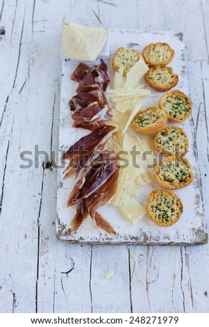 Traditional spanish tapas. Appetizer with spanish Ham and Cheese. Natural food concept. - stock photo