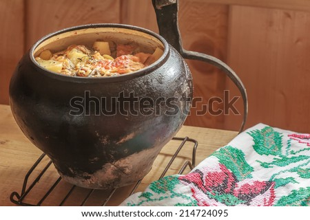 Traditional stew meal cooked in Russian wood-fired oven - stock photo