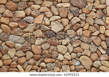 Traditional Stone Brick Wall made of fragment stones in irregular shapes - stock photo