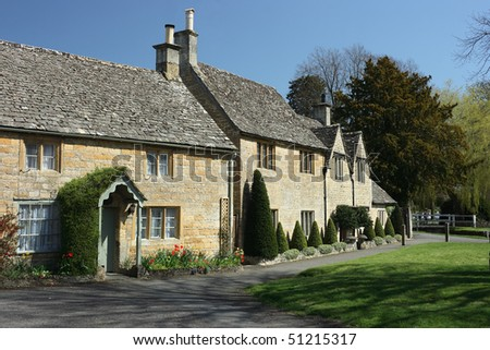 Traditional stone cottages in the Cotswolds village of Lower Slaughter - stock photo