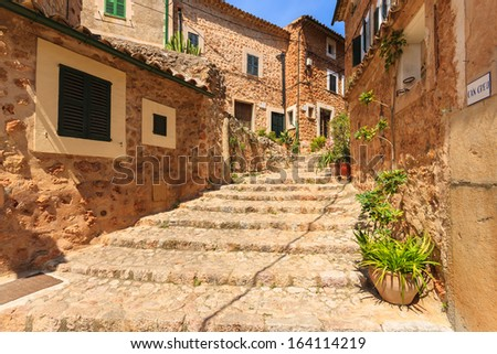 Traditional stone houses in narrow street, Fornalutx village, Majorca island, Spain