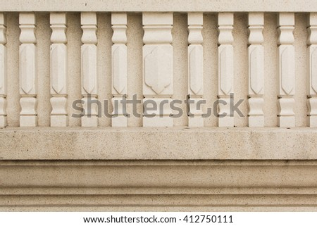 traditional stone wall with pillars in Thai style - stock photo