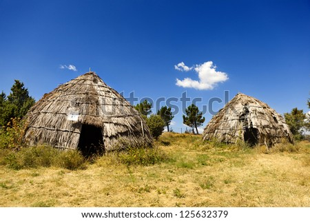 Traditional straws hut in greek country, on a sunny day