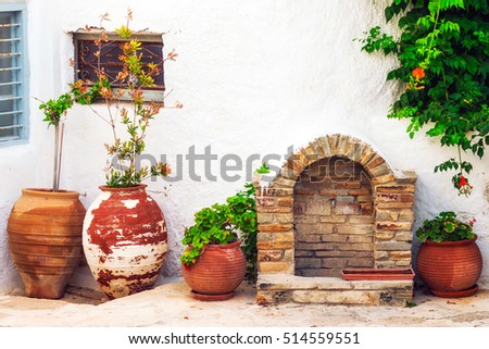 Traditional street faucet and decor in the old town of Naxos, Greece