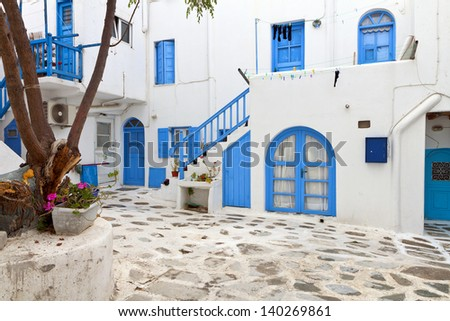Traditional streets and houses of Mykonos island in Greece - stock photo