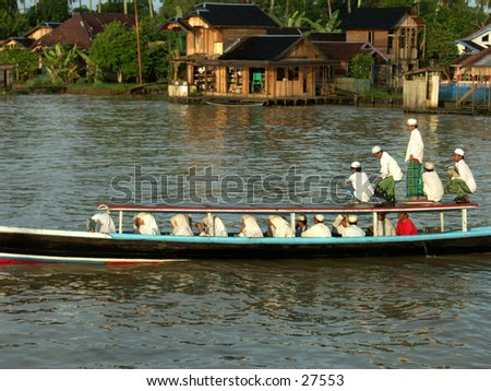 Traditional students go to school with their boat
