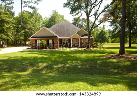 Traditional style house in rural country setting - stock photo